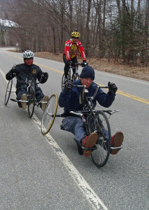 Geoff Krill, the winter sports director at New England Disabled Sports (603-745-628; www.nedisabledsports.org) and Cameron Shaw-Doran (front) roll out their handcycles. Being paralyzed from the waist down hasn't stopped them from getting out and enjoying the outdoors.