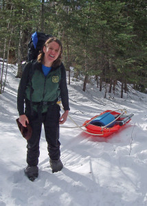 With work to do in the wilderness, this backcountry ranger in New Hampshire's White Mountain National Forest uses both a pack and a pulk to transport what she needs in winter.