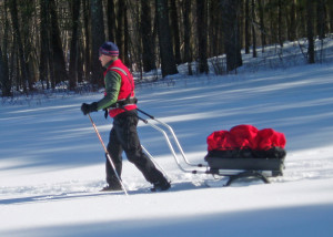 A pulk-and-harness system is one way to haul the gear you need in winter. This Nordic Cab pulk from Norway converts to a child carrier  for cross-country skiing or a wheeled cart or jogging stroller in the summer.