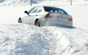It's a bummer when your Bimmer is in a (snow)bank...but if you're prepared, at least you won't hate the wait for AAA! (TireRack photo)
