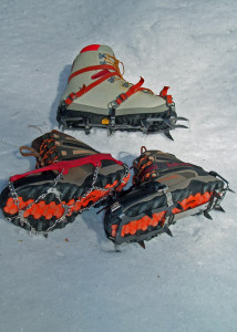 Clockwise from top are serious mountaineering crampons,  less weighty and cumbersome  are the modern, flexible Kahtoola KTS steel crampons, and, most versatile for trail hiking, Kahtoola MICROspike creepers.
