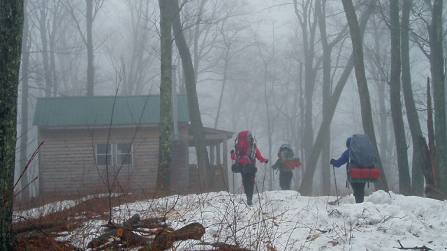 The cabin appearing suddenly through the fog and rain as we trudged up hill with heavy packs was a welcome sight.