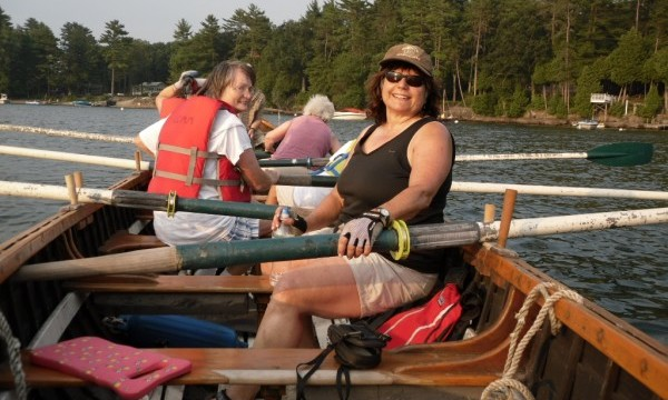 Pat aglow enjoys her first rowing experience in Longboats on Lake Champlain.  (Barbara Thomke photo)