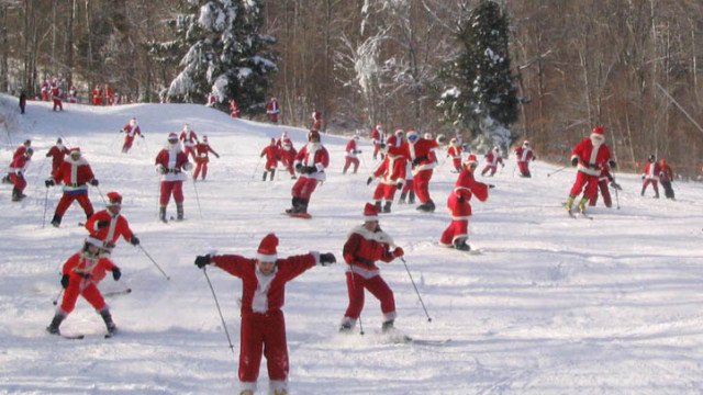 Will the real Santa please ski down? Actually, the real Santa was probably too busy to make it to Sunday River's Santa Sunday celebration in early December, but if he's smart, he and all the elves are out playing on the snow on Christmas Day! (Tim Jones photo)