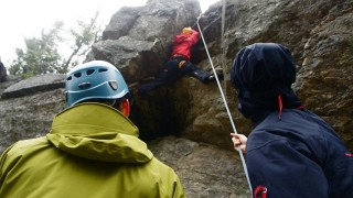 It's all about teamwork! Casey climbs Practice Session with the assistance of Dan and Sam belaying. Practice Session is a challenge and a good pitch to learn vertical crack climbing. (Caroline MDonald photo)