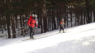 As these smiling skiers at Great Glen Trails in Pinkham Notch, NH discovered, there's nothing better on a cold afternoon than cross-country skiing in the wind-sheltered woods. (Tim Jones/EasternSlopes.com photo)