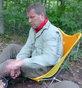 Often paired with an Insect Shield bandana, the Insect Shield Men's Technical Field Shirt makes it easy to relax around the cooking fire without constantly swatting bugs. (EasternSlopes.com photo)