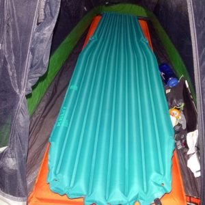 The Kelty PDa Air Chamber Sleeping Pad is lighter, packs smaller, and is more comfortable than a standard self-inflating mattress pad. (EasternSlopes.com photo)